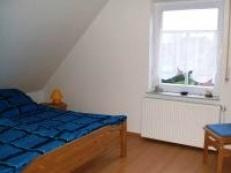 Schlafzimmer mit Doppelbett Fewo Obergeschoss