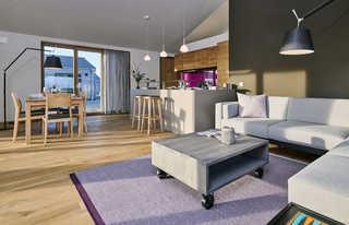Wohngesundes Designferienhaus mit exklusiver Ausstattung Offene Küche mit Wohn- und Essbereich