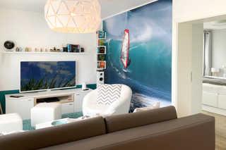 Sterntaucher 4 Seaside Gartenwohnung Wohnbereich mit Sofa und TV
