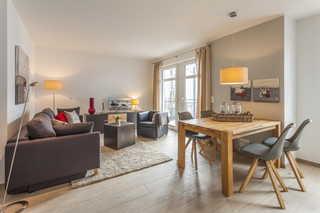 Villa Louisa Woge offener Wohn - und Essbereich mit Zugang zum Ba...