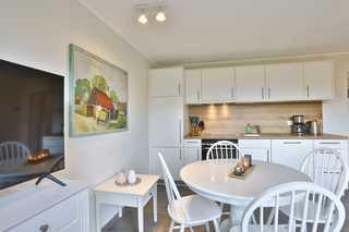 Ferienwohnung Zur Rebe Wohn- und Essbereich mit Küche