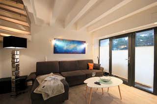 Haus Arkona, Whg. 2 AusZeit Wohnbereich mit Zugang zur Terrasse