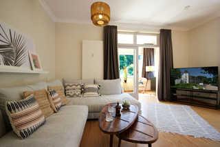 Ferienwohnung 40RB35 Florence, Villa Stranddistel Wohnraum mit Wintergarten