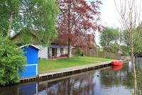 Meerhaus Sonne Südterrasse,Bootssteg mit Ruderboot direkt am Haus