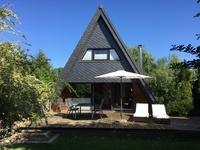 Zeltdachhaus mit Kamin Terrasse