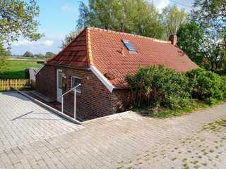 Fischerhaus am Deich 45233 Außenansicht Ferienhaus am Deich