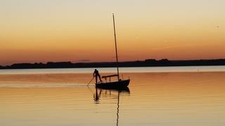 Ferienwohnungen/Appartements Ein Sonnenuntergang am See