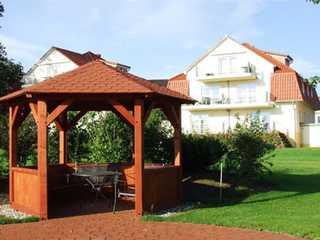 Ferienwohnung 68511 Blick vom Garten auf das Haus
