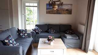 Ferienhaus Nordsee Oase Wohnzimmer mit Sitzbereich