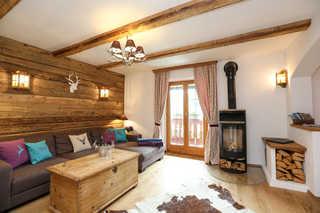 Ferienwohnung Maximilian **** Rustikales mit Altholz ausgebautes Wohnzimmer