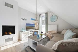 Mondmuschel Ferienwohnung gemütlicher Wohnbereich mit Sitzecke