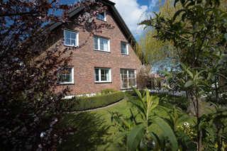 Appartementhaus Zingst - Urlaub zwischen Meer & Bodden Hausansicht von der Gartenseite
