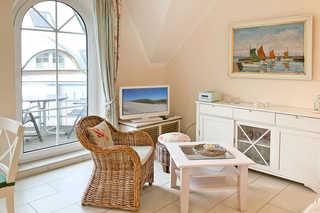 Rosenblüte Ferienwohnung Wohnbereich mit TV