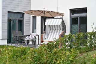 Sonnengarten Terrasse mit Strandkorb