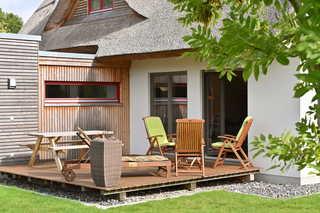 Reetdachhaus Treibholz Terrasse