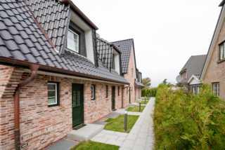 Ferienhaus Seestern Die Aussenansicht der Häuser Seestern in der Al...