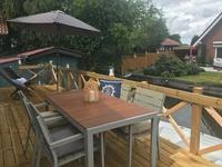 Ferienhaus Heinkens Hoek Balkon zum Wasser