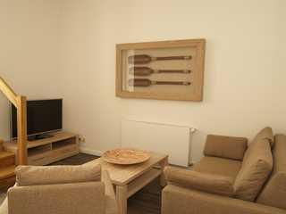 Seebad Villa Whg. 24-07 Der Wohnbereich mit gemütlicher Sitzecke und TV...
