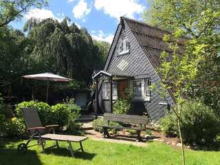 Hauszeit-Schönhagen - Sorgenfrei buchen Außenansicht mit Terrasse