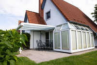 Ferienhaus Ellersiek Südostseite mit Wintergarten und Terrasse