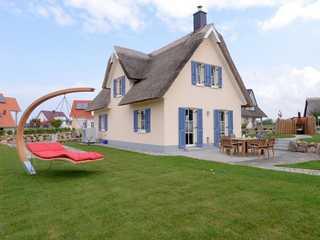 Arielle Ferienhaus Arielle-Ansicht auf den Garten und die Terrasse