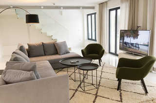 Strandloft 12 / Düne7 Wohnzimmer mit Sky TV und Kamin