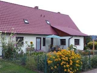 Ferienwohnung Mooskoppel Eingang zu Ferienwohnung mit Terrasse