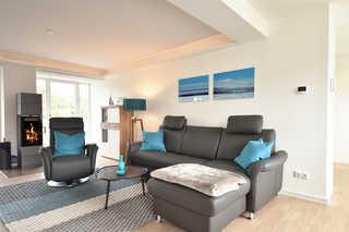 Aquamarin / Haus Arkona Wohnraum mit Kamin und Zugang zum seeseitigen B...