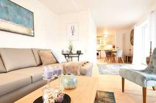 Traumdüne / Haus Strandbummler Wohnbereich mit Couchtisch