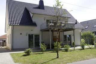 Haus Werder Wohnung 1 mit Kamin Vorderansicht