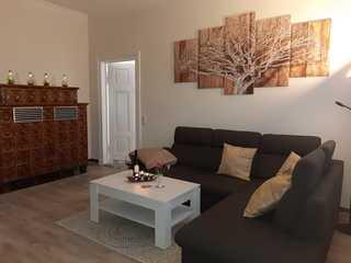 Ferienwohnung Achterdeck Wohnraum mit Kachelofen