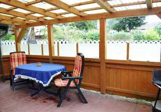 Bungalow Seeblick inkl. Boot Terrasse mit Gartenmöbeln