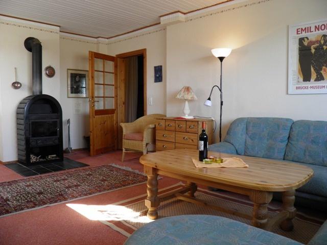 Fewo. PELLWORM 5 Personen Wohnzimmer mit Holzofen