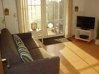 Ferienwohnung in Nessmersiel 200-145a Blick in den Wohnraum