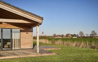 Wohngesundes Designferienhaus mit exklusiver Ausstattung Terrasse mit Blick zum Leuchtturm