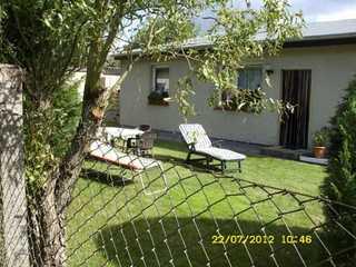 Ferienhaus - 63874 Blick auf das Ferienhaus mit Liegewiese