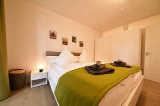 Strandgras Villa Sofie Schlafzimmer mit Doppelbett
